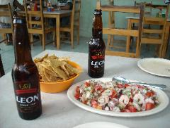 Plate of ceviche and two Leon beers